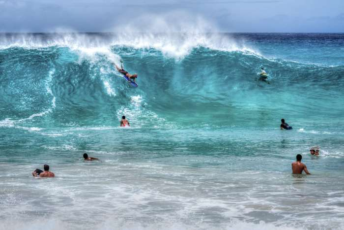A group of bodyboarders at Sandy Beach