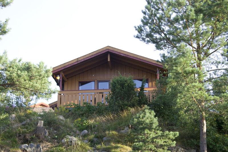Типичный домик в кемпинге около Рисера