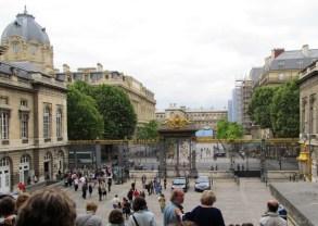 Exiting the Palais de Justice gates.