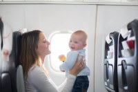 Tips on how to keep your baby happy during a flight-Uganda Safari News