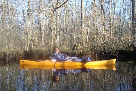 Mindie Burgoyne kayaking on Dividing Creek