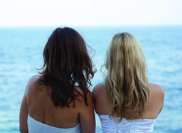 lesbian brides by ocean