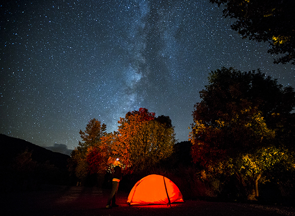 Camping with tent under night stars