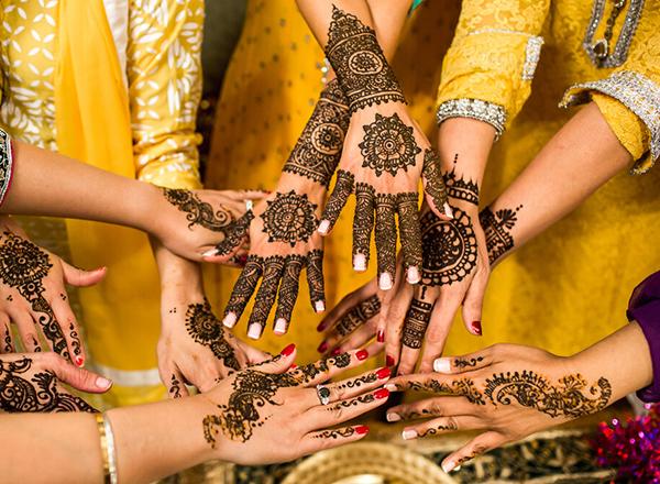 Women displaying henna hands