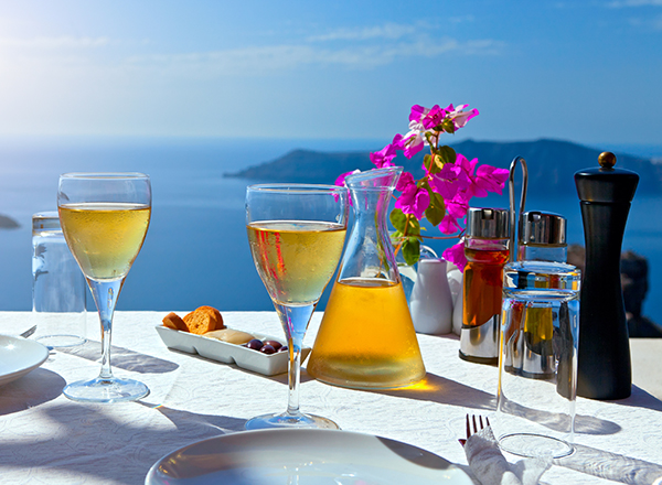 white wine on balcony overlooking the ocean, Santorini, Greece