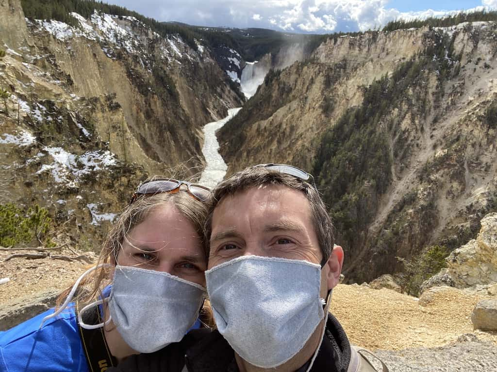 Chris and Christina in masks at Grand Canyon of the Yellowstone