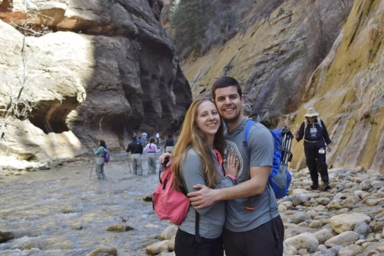 Brandon and Erin from Traveling Atlas in the Narrows in Zion National Park.