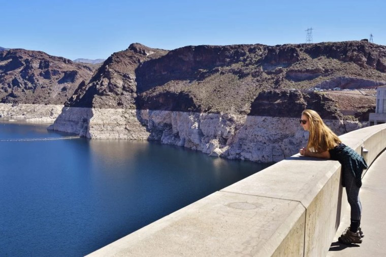 Erin leaning over the wall at the Hoover Dam.