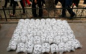 Guy Fawkes masks are seen on the ground as anti-government protesters gather in Istanbul's Taksim square