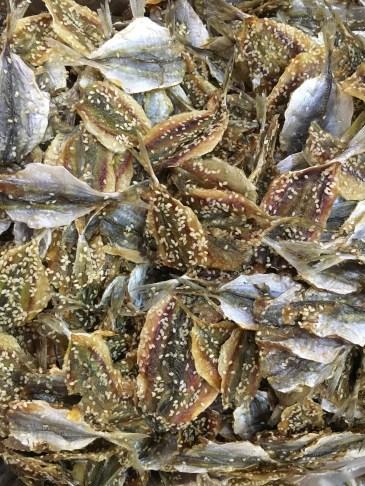 Dried, cured fish at a market in Bangkok @travelingintandem