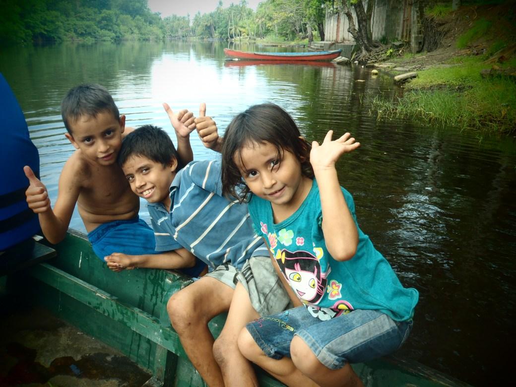 Local Kids Waving Goodbye; Monterrico, Guatemala; 2013