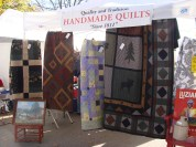 Quilt vendor old fashioned apple butter kettle fire