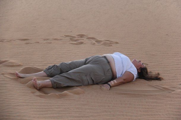 Making sand angels in the Arabian Desert.