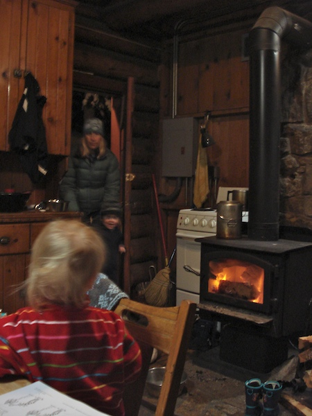 Wood burning stove in the Forest Service cabin.