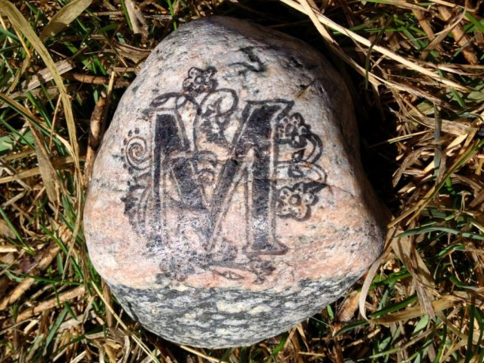 Montana Banksy leaves this calling card with her rock art.