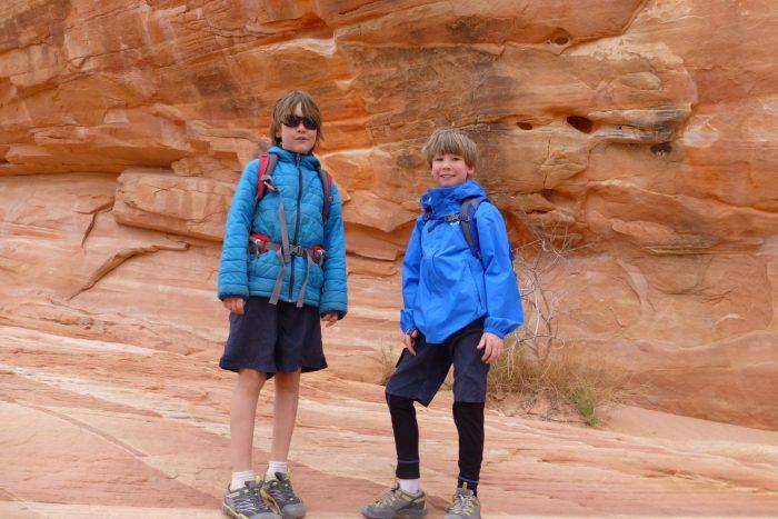 Boys in front of rocks