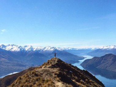 Tayler standing at the top of Roy's Peak overlooking Wanaka, NZ