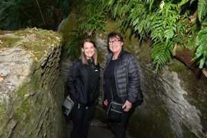 Mom and daughter standing at the entrance to the Glow Worm Caves in Te Anau, New Zealand
