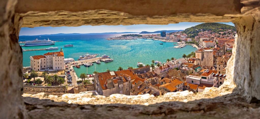 Split waterfront aerial panoramic view through stone window, Dalmatia region of Croatia