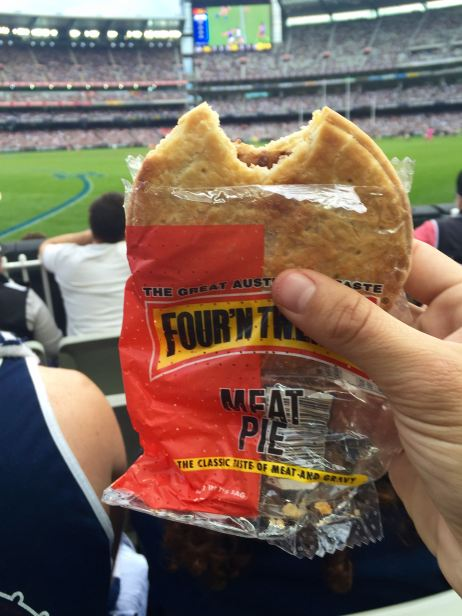 Eating Meat Pie at an Australian Footy Match
