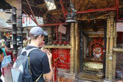 Saying a Prayer at a Hindu Shrine