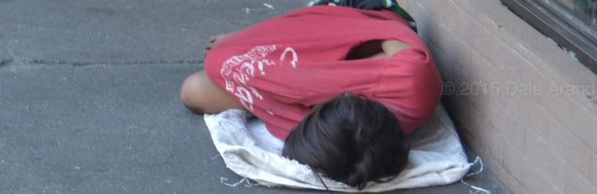 Homeless boy sleeping, inequality