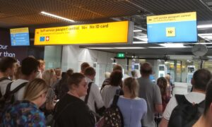 people standing in line waiting for passport control