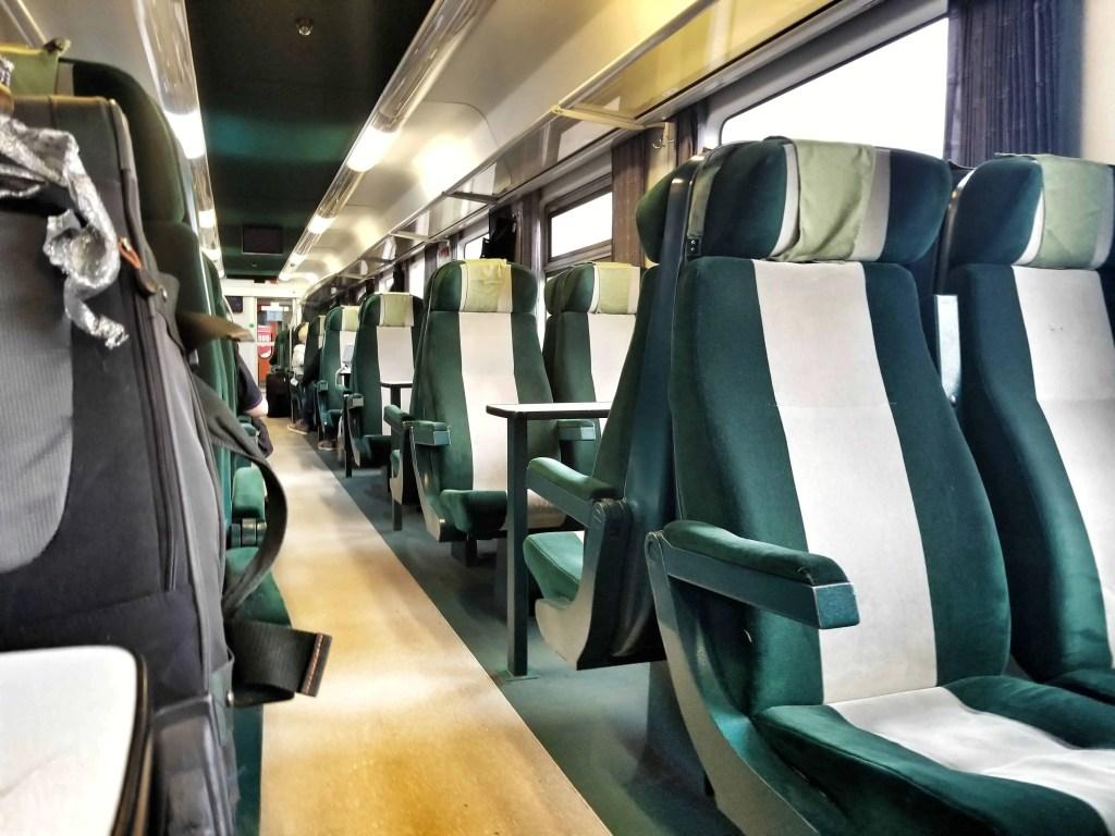 Dark green train seats on a train from Hungary to Romania, Transylvania.