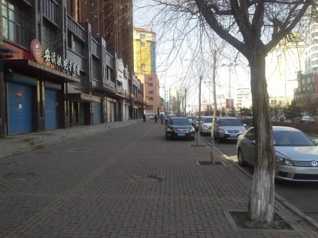 A short walk along Chang An Lu, I pass Tea Shops and a Russian Shop, which hasn't opened up yet.