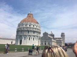 The city of Pisa. The round building is the Baptistery, the church behind that and the tower of Pisa in the background.