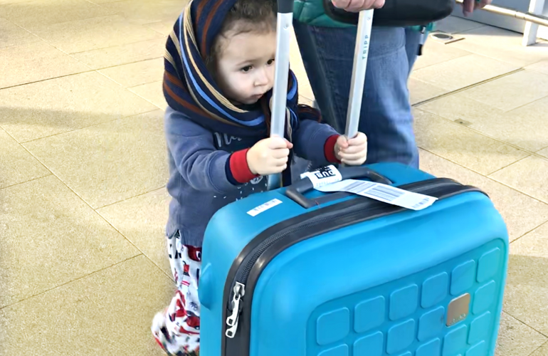 Toddler rolling suitcase through Dublin Airport-Packing Checklist for Babies and Toddlers