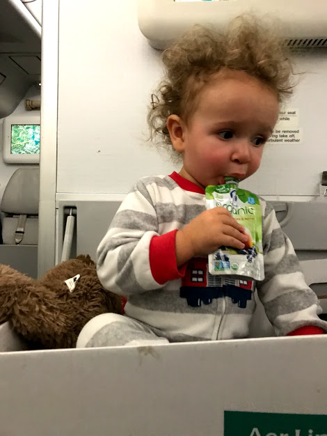 Baby flying in the bassinet seat on Aerlingus travel with small children