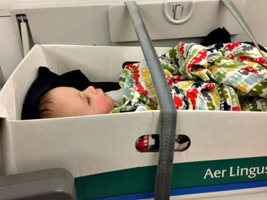 Baby in bassinet on Aerlingus trans-Atlantic flight-surviving jet lag in babies