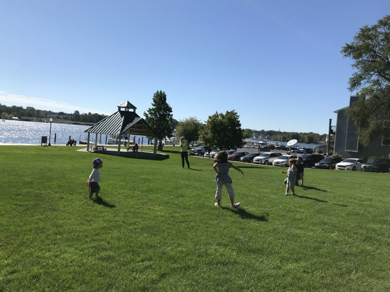 Children playing frisbee in Saugatuck Michigan
