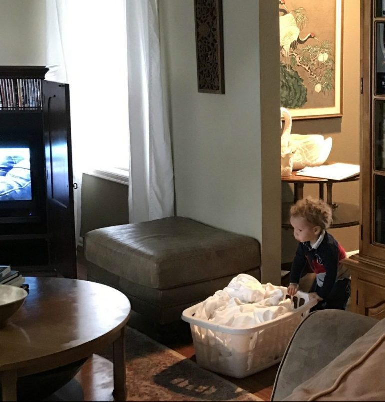 Toddler doing laundry at Airbnb for families