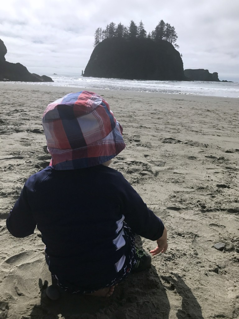 Toddler playing on Second Beach on the Pacific Ocean at Olympic National Park travel with small children