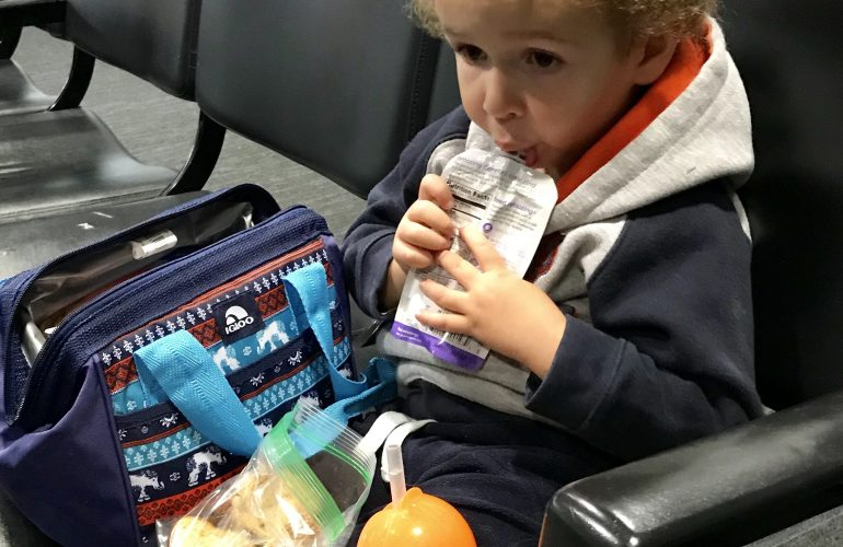 Toddler eating snacks at the airport, Toddler snacks for the plane
