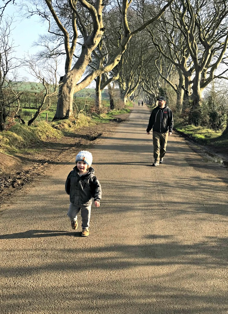 Toddler running along the Dark Hedges