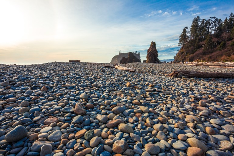 Pebbles on Ruby Beach with dramatic sky in the background in Olympic National Park