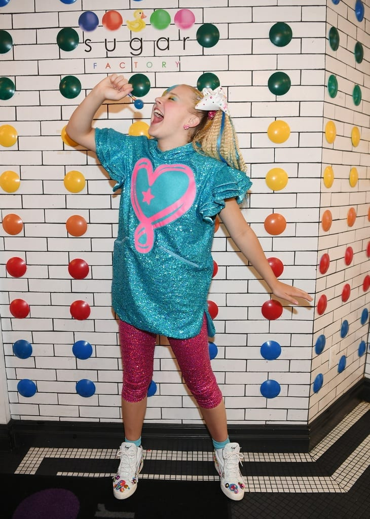 JoJo Siwa has fun with Sugar Factory Coutour Pop.