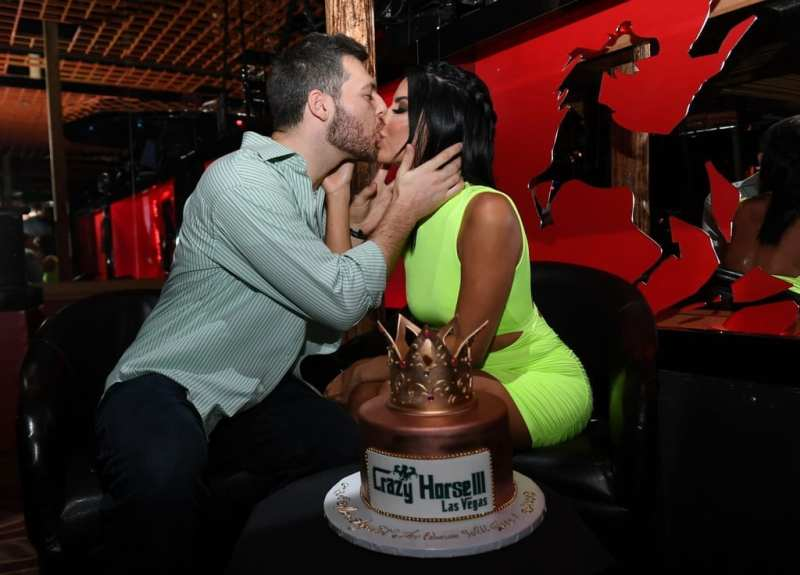 Larissa Lima and Eric Nichols with Cake