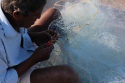 FIsherman fixing his fishing net