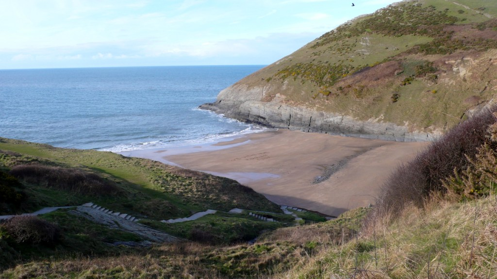 Mwnt's beautiful and secluded sandy beach, from a travel blog by traveljunkiegirl.com