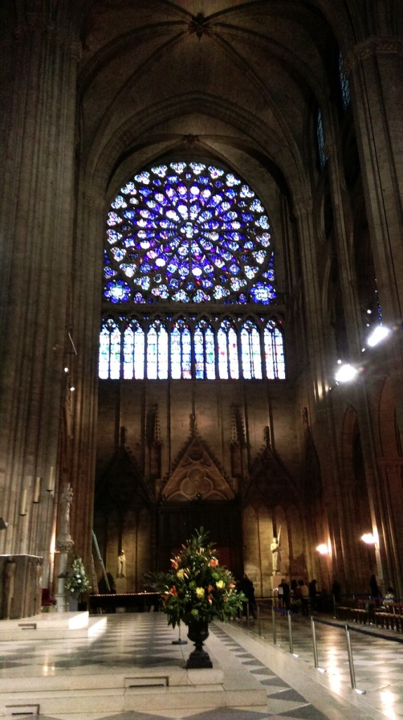 Interior of Notre-Dame showing one of the rose windows, Paris; from a travel blog by www.traveljunkiegirl.com