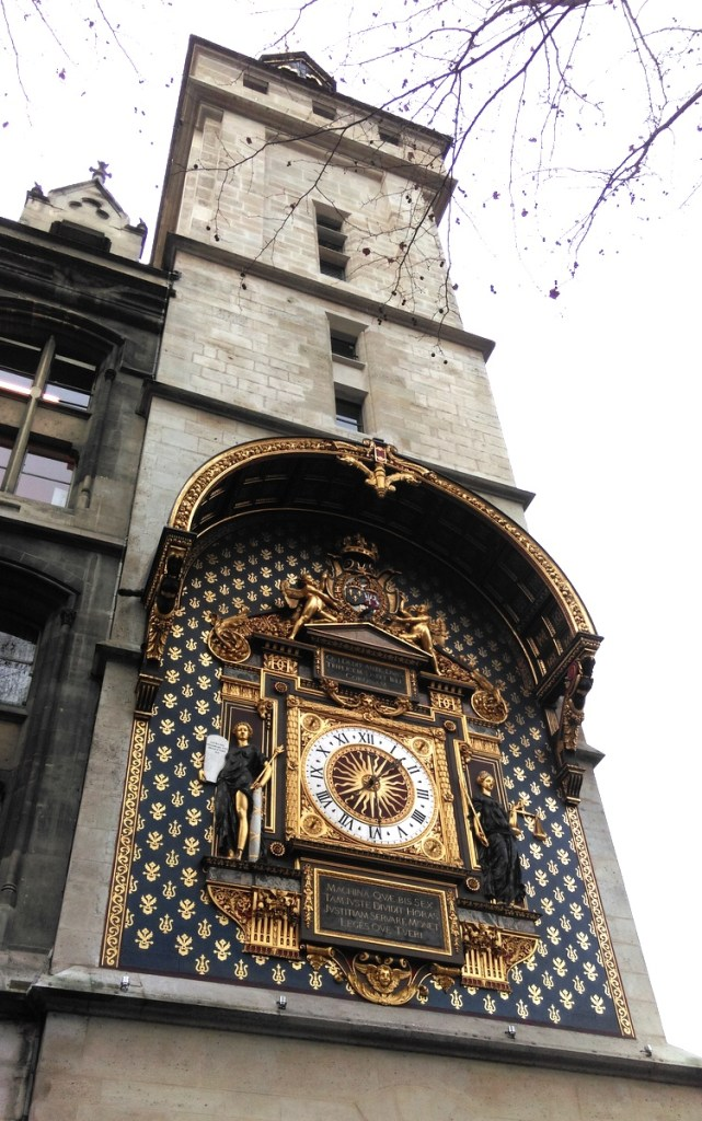 The clock on the north eastern tower of the Palais de Justice, Paris; from a travel blog by www.traveljunkiegirl.com
