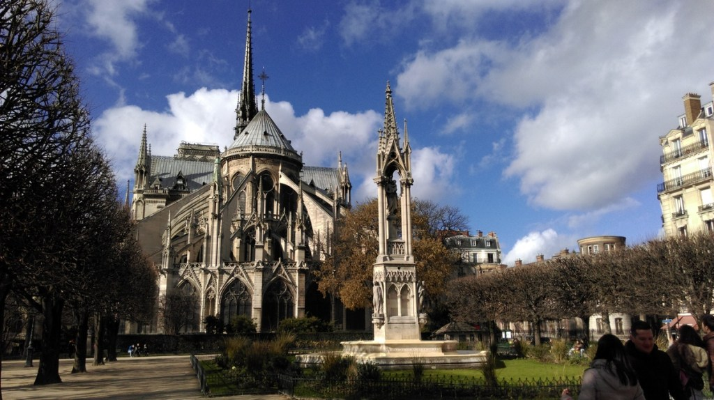 Square Jean XIII and the flying buttresses of Notre-Dame cathedral, Paris; from a travel blog by www.traveljunkiegirl.com