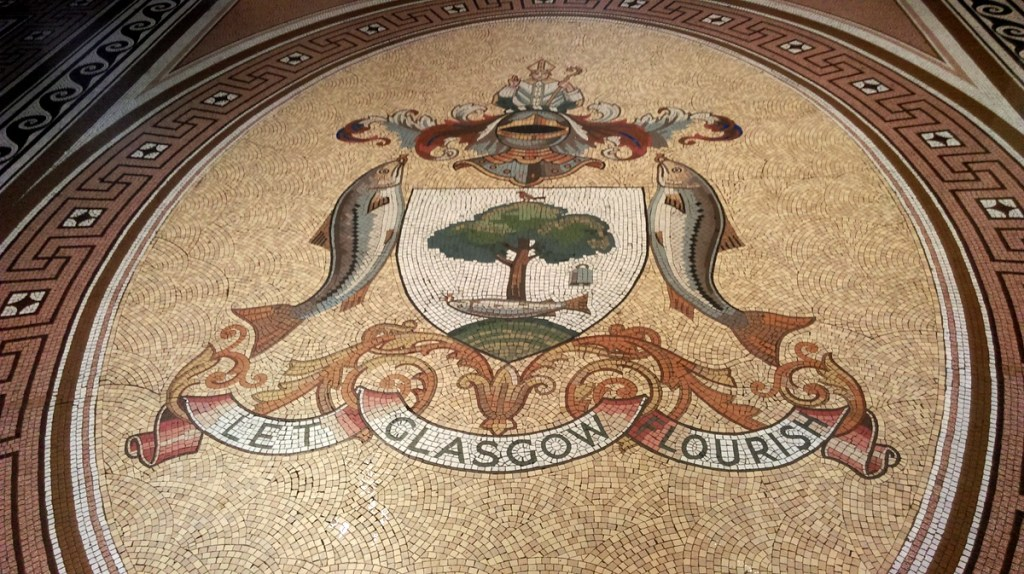 Glasgow Coat of Arms in mosaic on the entrance floor to the City Chambers building, Glasgow; from a travel blog by www.traveljunkiegirl.com