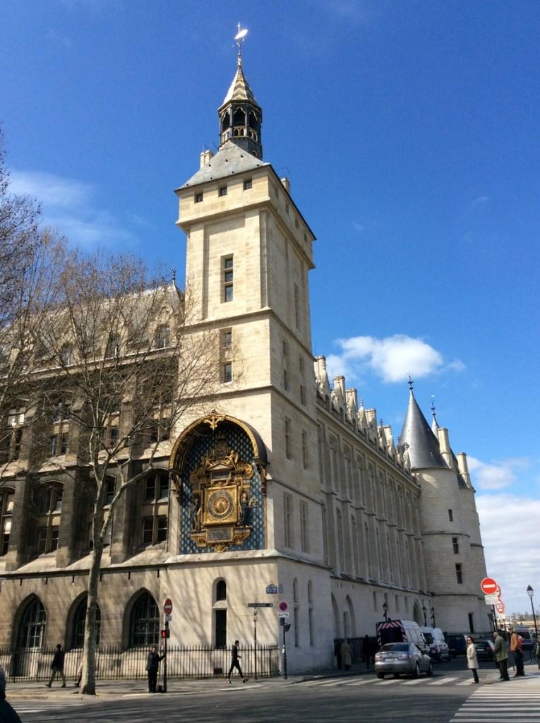 La Conciergerie and its famous clock, Paris; from a travel blog by www.traveljunkiegirl.com