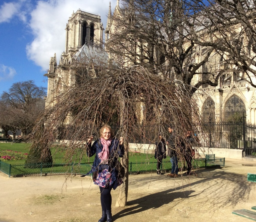 Tranquil gardens surrounding Notre-Dame cathedral, Paris; from a travel blog by www.traveljunkiegirl.com