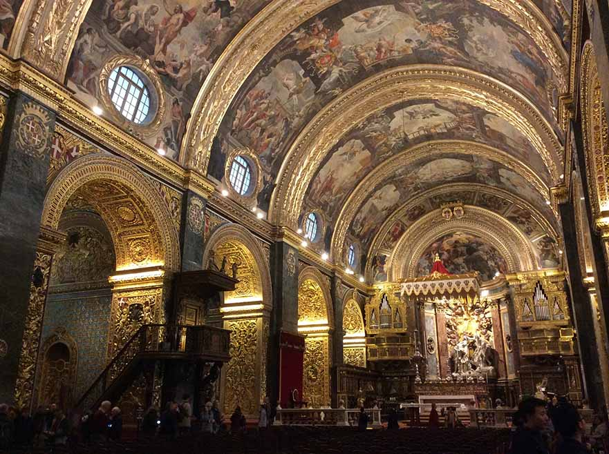 Golden Interior of St John's Co-Cathedral in Valletta, Malta; from a travel blog by www.traveljunkiegirl.com